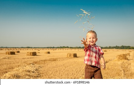 Little cute child boy near bale of hay.