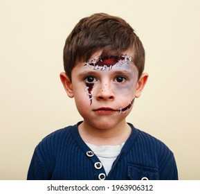 little cute child with facepaint on birthday party, zombie Apocalypse facepainting, halloween preparing concept, lifestyle people