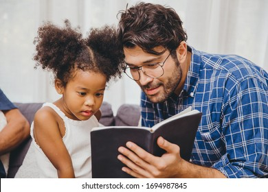 Little cute child interesting the book love to read and learn support from dad to smart kid concept.