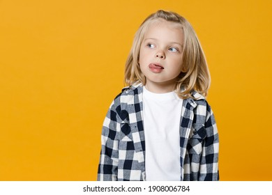 Little cute fun happy blond long-haired kid boy 4-5 years old wearing casual clothes posing isolated on bright yellow wall color background children studio portrait. People childhood lifestyle concept