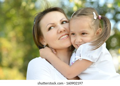 Little cute girl with her mother on the walk