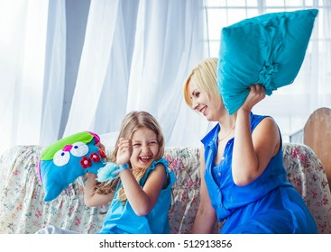 little cute girl with her mother having fun together