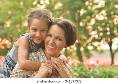 Little cute girl with mother in park