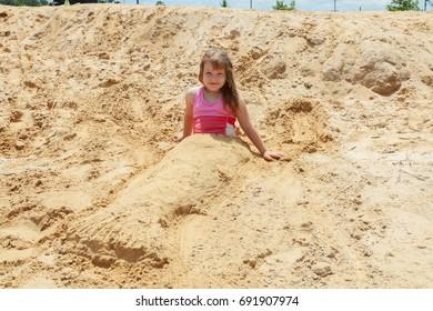 Little cute girl on beach Beautiful little girl in the sand on the beach