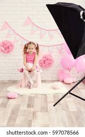Little cute girl with party decor at photo shooting