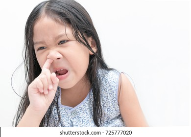 Little cute girl pick her nose on white background, Health care and hygiene concept