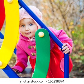 little cute girl playing at the playground