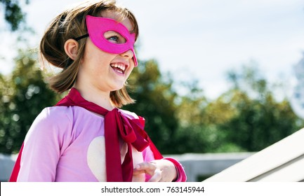 Little cute girl playing superhero