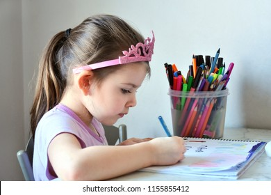 Little cute girl with pony tail and hair band drawing pencil with bunch of colorful pencils on background