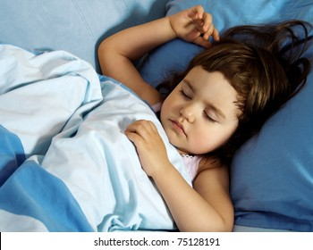 Little Cute Girl Quietly Sleeping in Her Bed