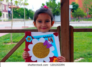 Little cute girl with school report. Successful, happy children going to an upper class.(okul karnesi)