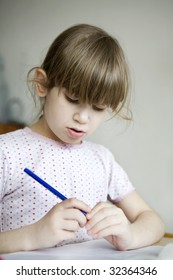 little cute girl seven years old do homework. Schoolgirl