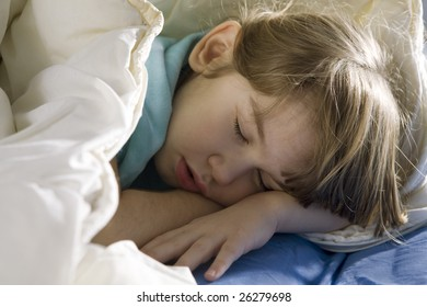 little cute girl sleeping in the bed
