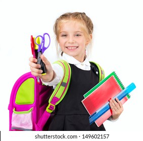 little cute girl with a stationery on a white background