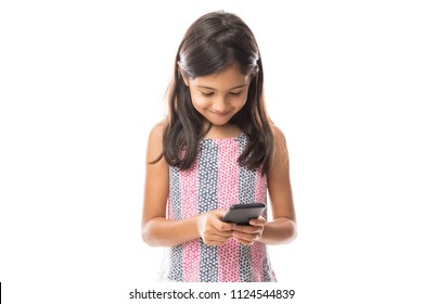 Little cute girl surprised with an interesting information on mobile smartphone isolated on white background