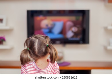 little cute girl watching tv