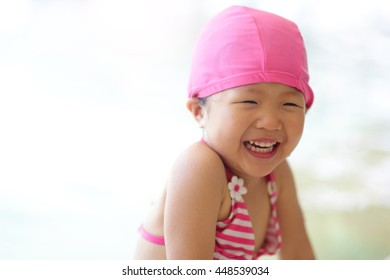 little cute girl wear swimsuit play happily and exciting in the swimming pool, asian