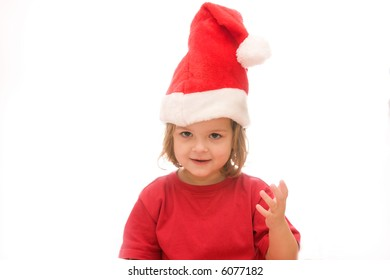 little, cute girl wearing Santa's hat, isolated on white