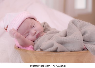 Little cute newborn baby is going to sleep.