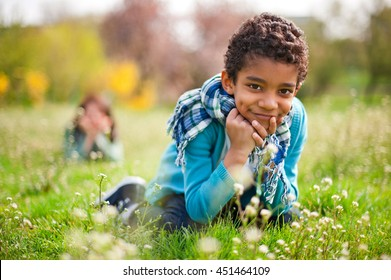 Little cute real black boy smiling in the park