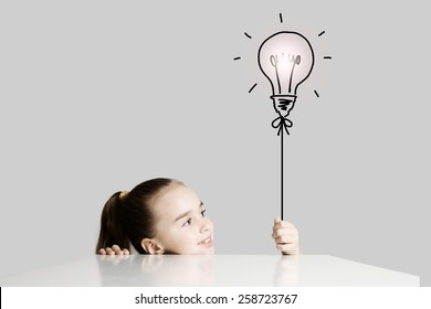 Little cute school girl and electric bulb
