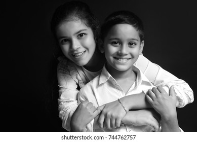 little cute Sister and Brother hugging playing on Black background, happy family smiling