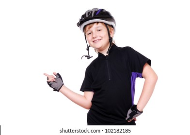 Little cyclist  pointing with his finger to the copy space