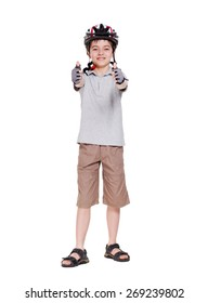 Little cyclist showing thumbs up full length portrait in a white studio