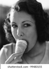 A little dab on the nose will do ya' as a young woman eats ice cream from a cone