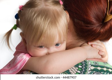 The little daughter embraces mum for a neck.