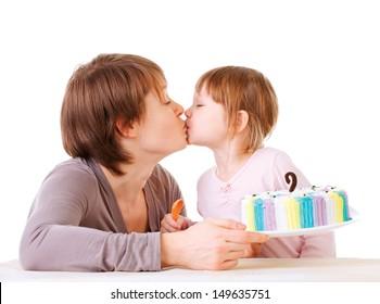 Little daughter kissing her mother. torte