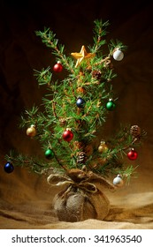 Little decorated Christmas tree background