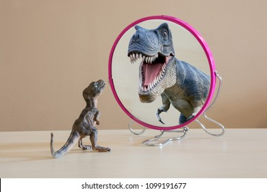 Little dinosaur with self confidence see a great dinosaur looking itself into the mirror