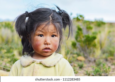 Little dirty native american girl in the countryside.