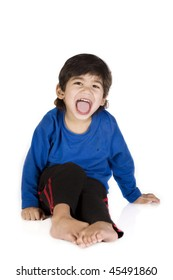 Little disabled boy with cerebral palsy sitting, isolated on white, mouth open in wide smile