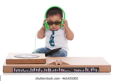 Little DJ.  Adorable biracial baby pretending to be a DJ.  Isolated on white.