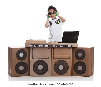 Little DJ.  Adorable mixed race boy pretending to be a DJ.  Isolated on white.