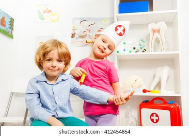 Little doctor doing flu shot to her patient