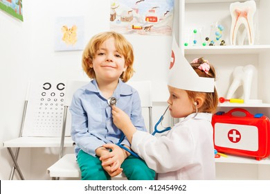 Little doctor examining boy with stethoscope