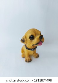 Little dog miniature sticking out its tongue.