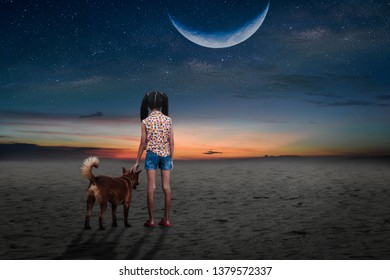 The little and the dog walked in the desert on a lonely half moon night.