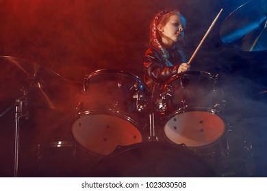 A little drummer girl. Scene, light.
