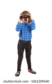 Little elegant boy looking through spyglass in front of image isolated on white background