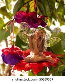 The little elf on a flower in a fairy garden