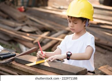 "Little ""engineer"" ; , concept carpenter"