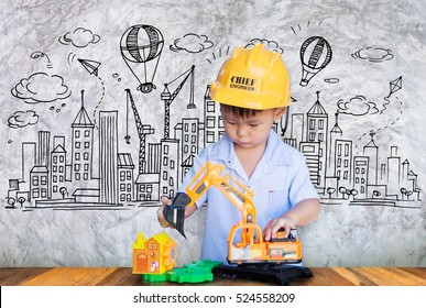 Little engineer plays with toy,Concept of a small creative engineer.