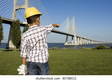 """Little """"engineer"""" pointing to a bridge"""