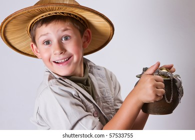 little explorer is amazed by his newest find. A pot of ancient gold coins and jewelry