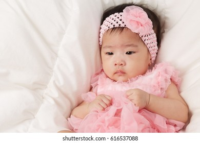 Little Fairy Baby Asian Girl With Pink Tutu Skirts on white bed