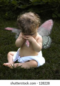 Little Fairy baby with torn wing